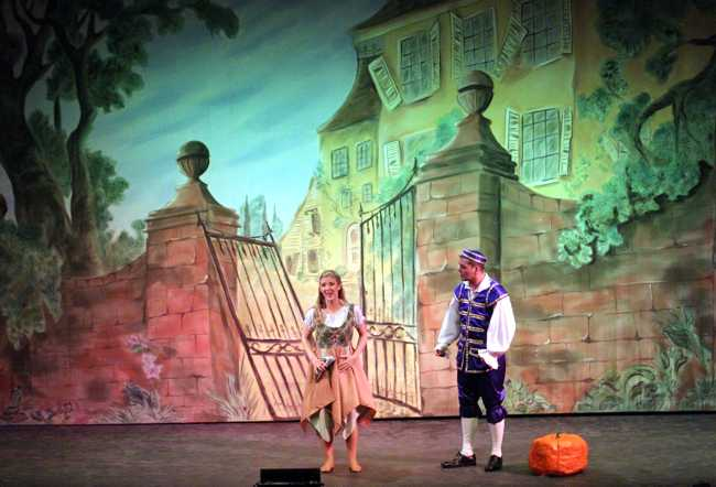 Cinderella Pantomime Broxbourne: Cinderella and Buttons outside Hardup Hall with slipper